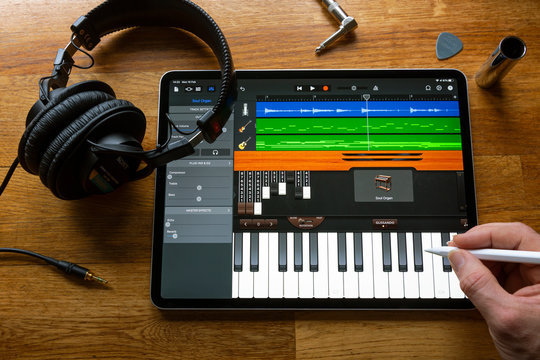 BATH, UK - FEBRUARY 10, 2020: GarageBand music making application being used to compose a song on an Apple iPad Pro in a home environment.