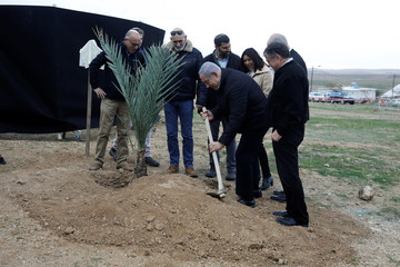 Israeli Prime Minister Benjamin Netanyahu plants a tree during an event marking Tu BiShvat, the Jewish Arbor Day, in the Israeli settlement of Mevo'ot Yericho, in the Israeli-occupied West Bank