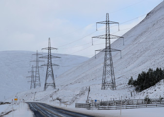 Pylons carry the Beauly to Denny Power line near the Drumochter Pass, Scotland