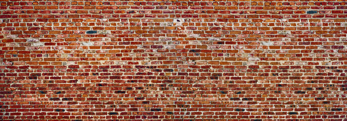 Photo sur Plexiglas Brick wall Panoramic rugged old red brown bricks wall. texture background