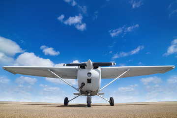 white sports plane againstr a perfect blue sky