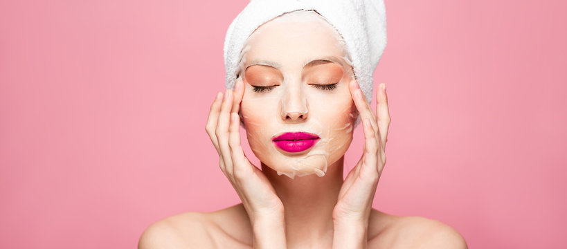 panoramic shot of naked woman in moisturizing face mask with closed eyes isolated on pink