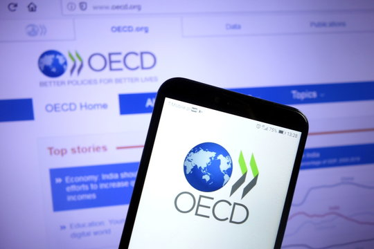 KONSKIE, POLAND - December 07, 2019: Organisation for Economic Cooperation and Development OECD logo on mobile phone