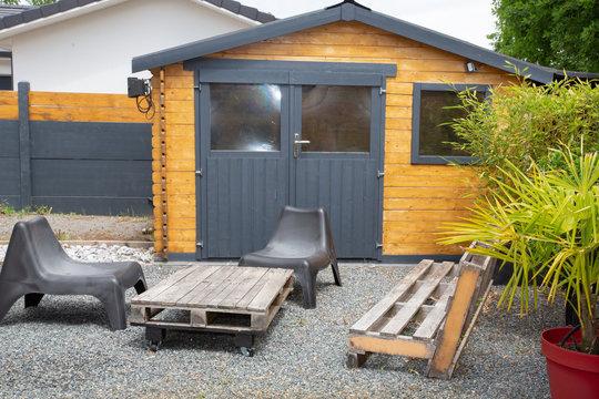 home garden wood hut at bottom of garden house