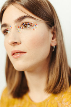 beauty portrait natural girl with colorful dot make up