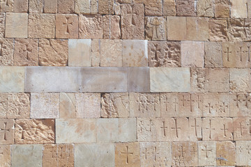 old brick wall background with ancient engravings of cross sign