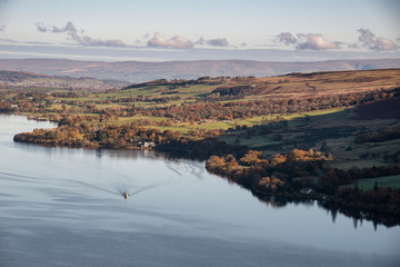 Aluminium Prints Dark grey Beautiful Autumn Fall landscape of Ullswater and surrounding mountains and hills viewed from Hallin Fell on a crisp cold morning with majestic sunlgiht on the hillsides