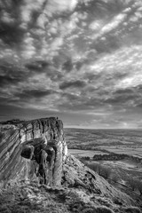 Aluminium Prints Dark grey Epic Peak District black and white Winter landscape of view from top of Hen Cloud over countryside and towards Tittesworth Reservoir