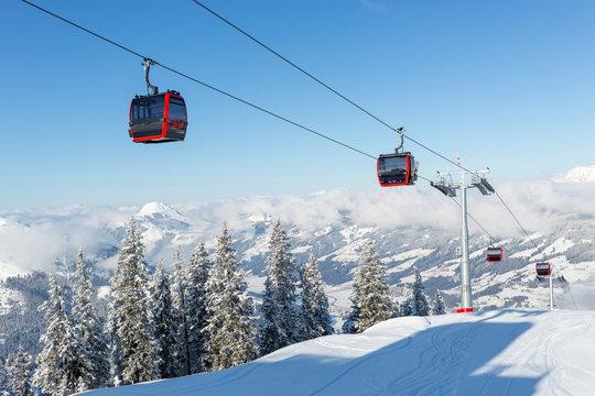 Modern ski gondola in an Austrian ski resort on a snowy winter day.