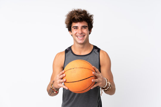 Young caucasian man over isolated white background playing basketball