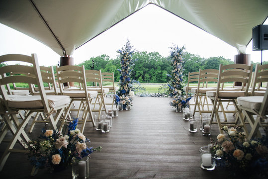 wedding arch and chairs on wedding ceremony in the garden