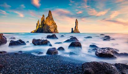 Breathtaking summer sunrise on Reynisdrangar cliffs in Atlantic ocean. Gorgeous morning scene of...
