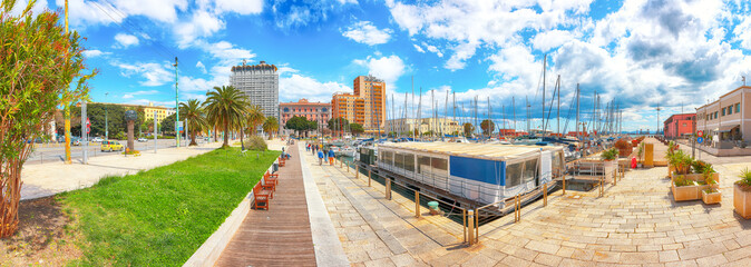 Splendid spring Cityscape with marina and Yachts and boats in town Cagliari