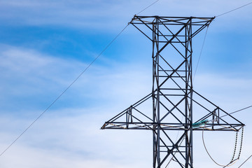power transmission tower on background of blue sky