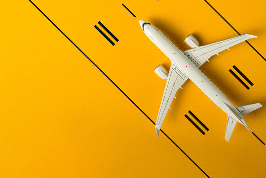 Top view of the plane on airport runway. Aviation industry and Summer travel concept. banner