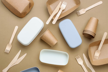 Brown kraft paper food containers on beige background
