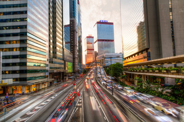 Urban rush hour traffic in Hong Kong's downtown Connaught Road Central business hub during sunset hours