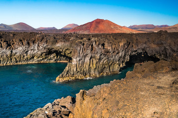 Beautiful postcard landscape view of Los Hervideros caves among colorful volcanic terrain in Lanzarote, Canary Islands, Spain - popular vacation destination
