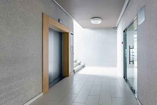 Luxury lifestyle design. Modern interior design. Modern steel elevator. Stairs. Nobody inside.