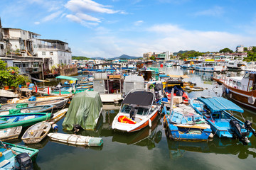 Fishing boats dock at the busy harbor in Sai Kung, Hong Kong, a town famous for its quaint fishing villages and the floating seafood market Fotomurales