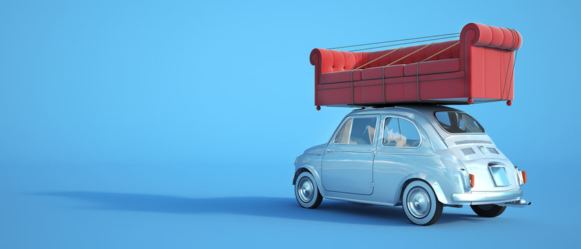 Small car with big sofa on the roof