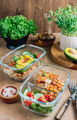 Foto op Canvas Assortiment Healthy meal prep containers with chickpeas, chicken, tomatoes, cucumbers and avocados. Healthy lunch in glass containers on beige rustic background. Zero waste concept. Selective focus.