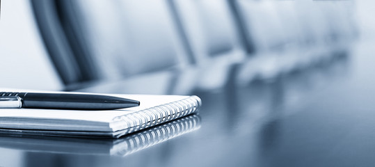 Notepad on a table with pen before meeting, blue tone, business concept with copy space Fotobehang