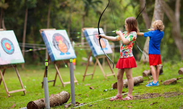 Archery for child. Kids shoot a bow. Arrow, target