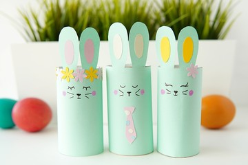 Happy Easter party decoration, paper crafts for kids, bunnies made from toilet paper tubes.