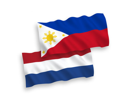 National vector fabric wave flags of Philippines and Netherlands isolated on white background. 1 to 2 proportion.