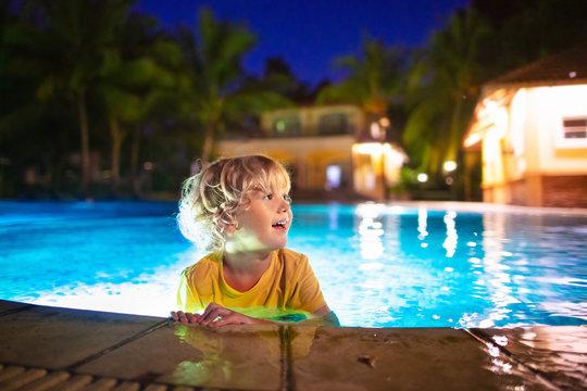 Kids in swimming pool at night