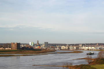 View at the river Rhine and the skyline of the Dutch city Arnhem, in December 2019