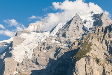 Bernese Alps panorama with Eiger glacier and cumulus clouds, Switzerland