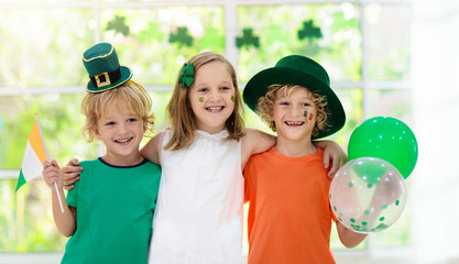 Kids celebrate St Patrick Day. Irish holiday. Wall mural
