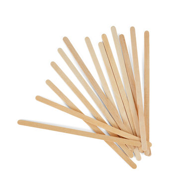 Wooden stirrers for coffee, tea and drinks, laid out in random order, isolated on a white background.