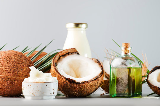 MCT Coconut butter or coconut oil. Organic healthy food, beauty and SPA concept. Gray background. Copy space