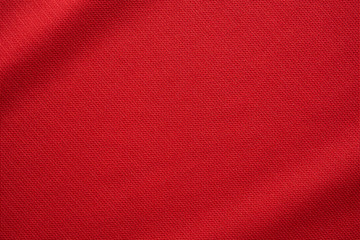 Photo sur Aluminium Tissu Red sports clothing fabric football jersey texture close up
