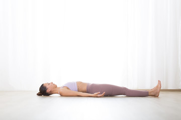 Fotomurales - Portrait of gorgeous active sporty young woman practicing breathing exercises in yoga studio. Healthy active lifestyle, working out indoors in gym.