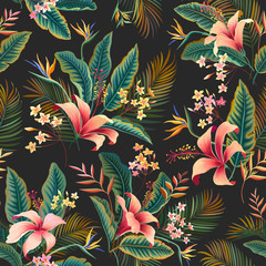 seamless floral pattern. tropical floral tropical pattern with hibiscus and palm tree leaves on dark background