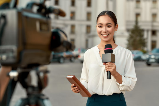 On air. TV reporter presenting the news outdoors. Journalism industry, live streaming concept.