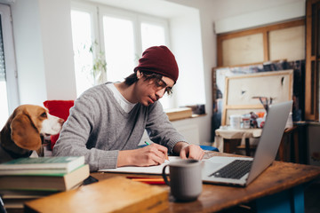 self employed young man working from his home