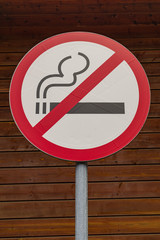 No smoking sign, with wooden wall background
