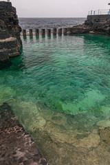 ocean water natural pool, with Atlantic Ocean and clouds background, Charco Azul, La Palma island, Canary islands, Spain