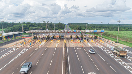 Aerial image highway toll plaza and speed limit, view of automatic paying lanes, non-stop.