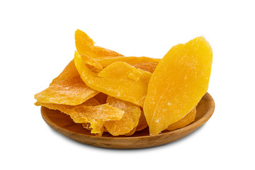 Fototapete - Pile of dehydrated mango in a wooden plate on white background with clipping path.