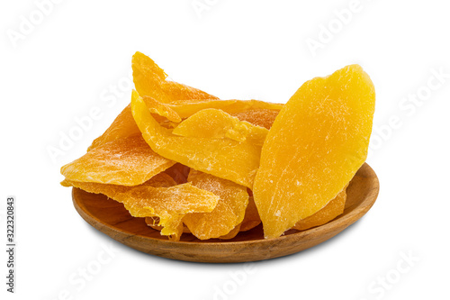 Fototapete Pile of dehydrated mango in a wooden plate on white background with clipping path.