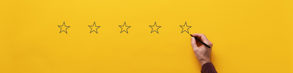 Drawing fiver stars over yellow background