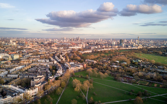 London skyline. Aerial drone photo from Primrose Hill in North London looking south with many key landmarks in view.