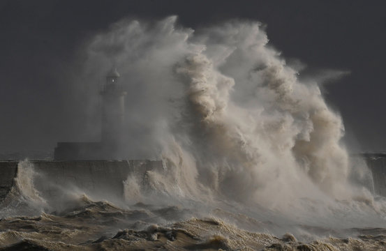 Large waves hit the harbour wall at Newhaven, southern Britain