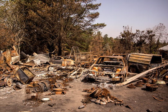 Building and cars burnt during bushfires in Australia